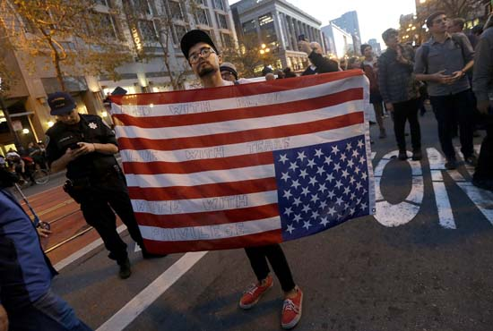 <div class='meta'><div class='origin-logo' data-origin='AP'></div><span class='caption-text' data-credit='AP'>A protester carries an upside down American flag in opposition of Donald Trump's presidential election victory in San Francisco, Wednesday, Nov. 9, 2016. (AP Photo/Jeff Chiu)</span></div>
