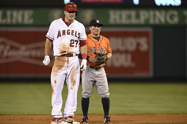 "<div class=""meta image-caption""><div class=""origin-logo origin-image ap""><span>AP</span></div><span class=""caption-text"">Los Angeles Angels' Mike Trout, left, stands on second after stealing the base as Houston Astros second baseman Jose Altuve. (AP Photo/Kelvin Kuo)</span></div>"