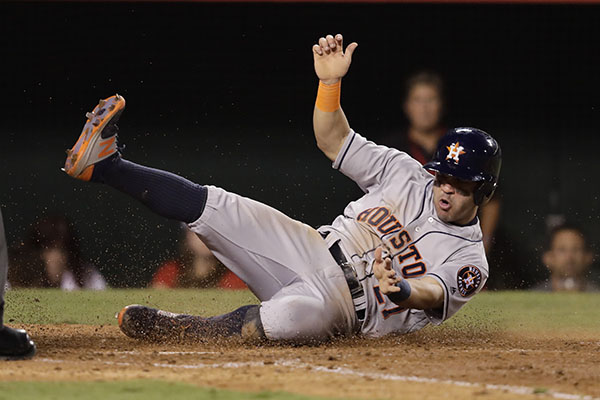 "<div class=""meta image-caption""><div class=""origin-logo origin-image ap""><span>AP</span></div><span class=""caption-text"">Houston Astros' Jose Altuve scores on a single hit by Evan Gattis during the seventh inning of a baseball game against the Los Angeles Angels, Saturday, Oct. 1, 2016. (AP Photo/Jae C. Hong)</span></div>"