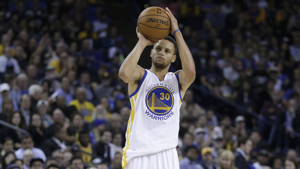 Golden State Warriors' Stephen Curry shoots against the Dallas Mavericks during the second half of an NBA basketball game Wednesday, Nov. 9, 2016, in Oakland, Calif.