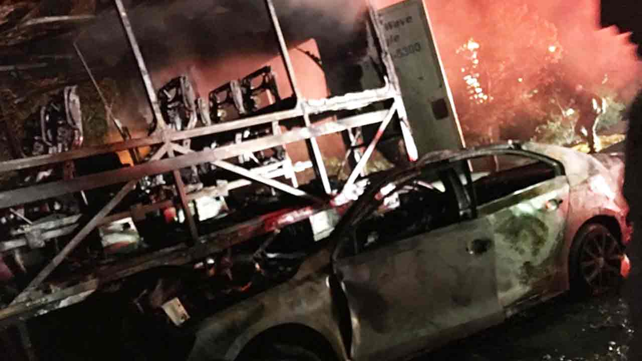A bus and another vehicle are seen destroyed after a fiery crash that left one person dead in Chino Hills early morning Sunday, Nov. 13, 2016.