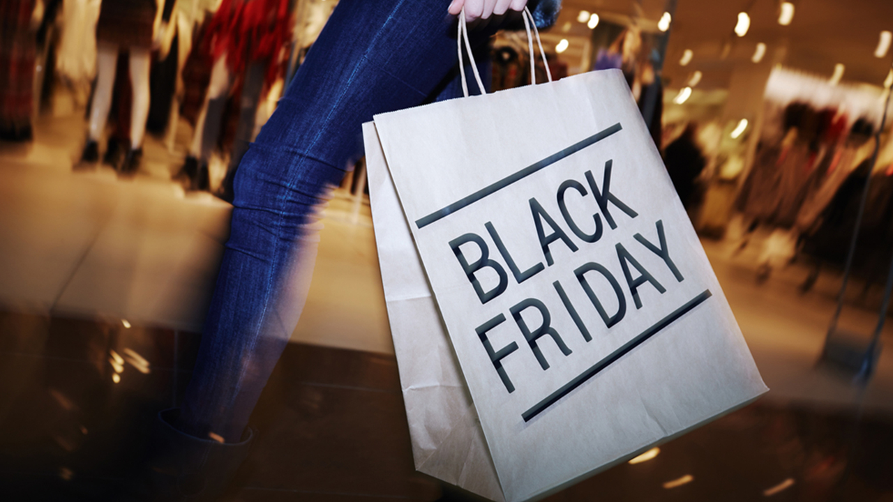 """Image of shopper with a bag that says """"Black Friday"""""""