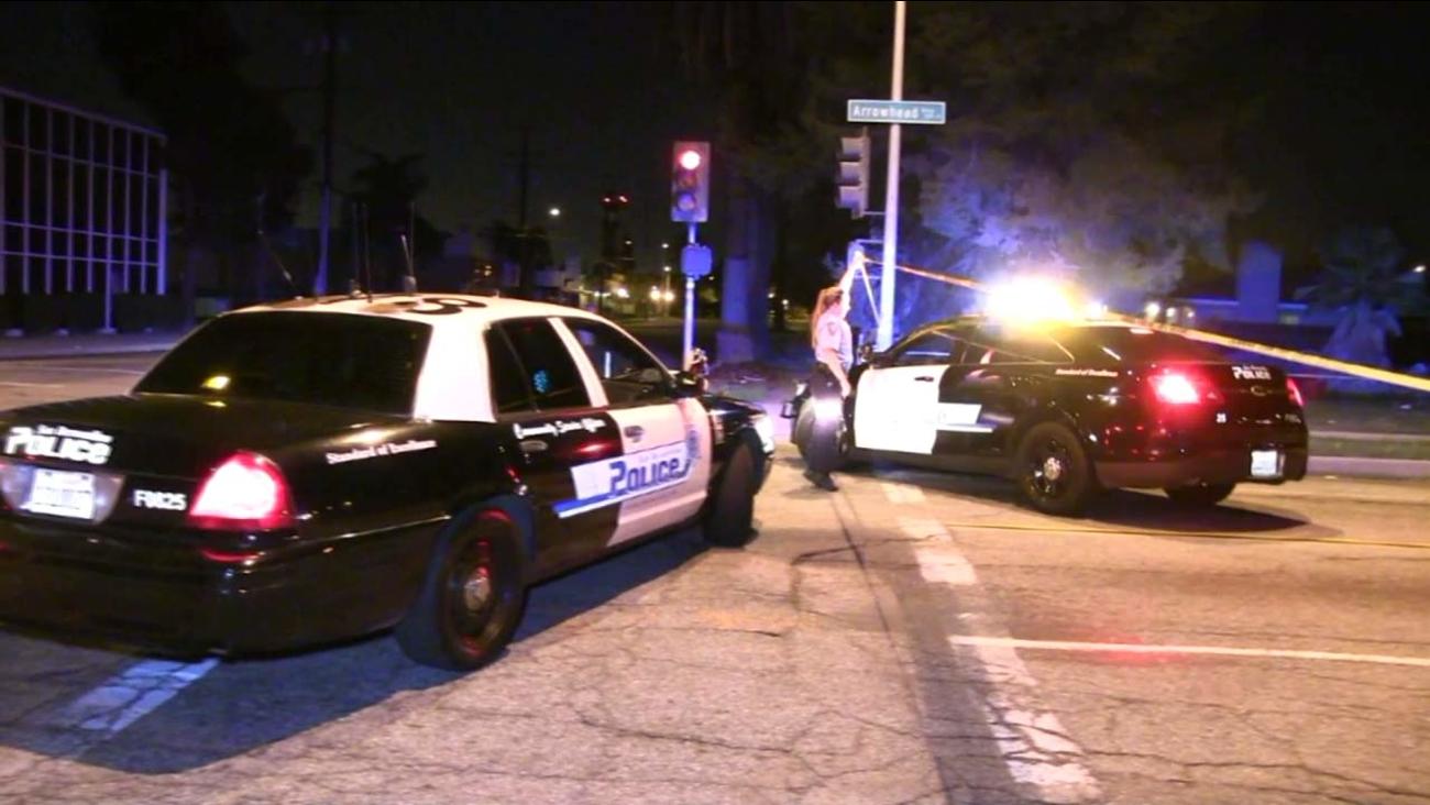 Police vehilces are shown at the scene of a fatal shooting in San Bernardino on Sunday, Nov. 13, 2016.