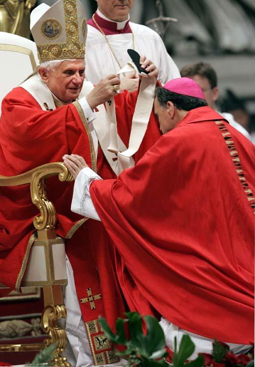 <div class='meta'><div class='origin-logo' data-origin='AP'></div><span class='caption-text' data-credit='AP/Pier Paolo Cito'>Pope Benedict XVI bestowes the pallium, or a woolen shawl, on Daniel N. DiNardo, Archbishop  of Galveston-Houston, TX, during a mass</span></div>
