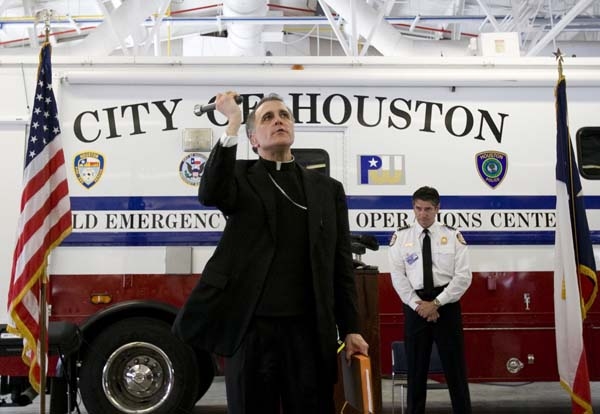 <div class='meta'><div class='origin-logo' data-origin='AP'></div><span class='caption-text' data-credit='AP/Nick de la Torre/Chronicle'>Cardinal Daniel N. DiNardo sprinkles holy water after he says a prayer during the grand opening ceremony for Houston Fire Department Station 8</span></div>