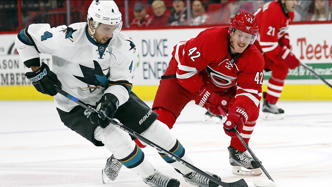 Carolina Hurricanes' Joakim Nordstrom (42) and San Jose Sharks' Brenden Dillon (4) skate to the puck during the second period of an NHL hockey game, Tuesday, Nov. 15, 2016.