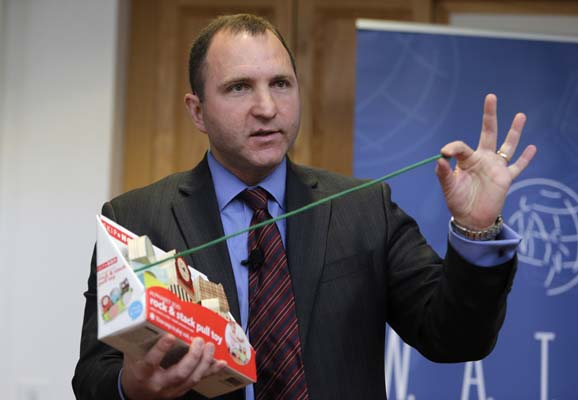 """<div class=""""meta image-caption""""><div class=""""origin-logo origin-image ap""""><span>AP</span></div><span class=""""caption-text"""">James Swartz, director of World Against Toys Causing Harm Inc., holds up a string on a children's pull toy at Children's Franciscan Hospital in Boston, Wednesday, Nov. 19, 2014. ((AP Photo/Charles Krupa))</span></div>"""