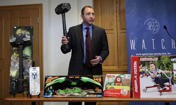 """<div class=""""meta image-caption""""><div class=""""origin-logo origin-image ap""""><span>AP</span></div><span class=""""caption-text"""">James Swartz, director of World Against Toys Causing Harm Inc., holds up toy battle hammer at Children's Franciscan Hospital in Boston, Wednesday, Nov. 19, 2014. ((AP Photo/Charles Krupa))</span></div>"""