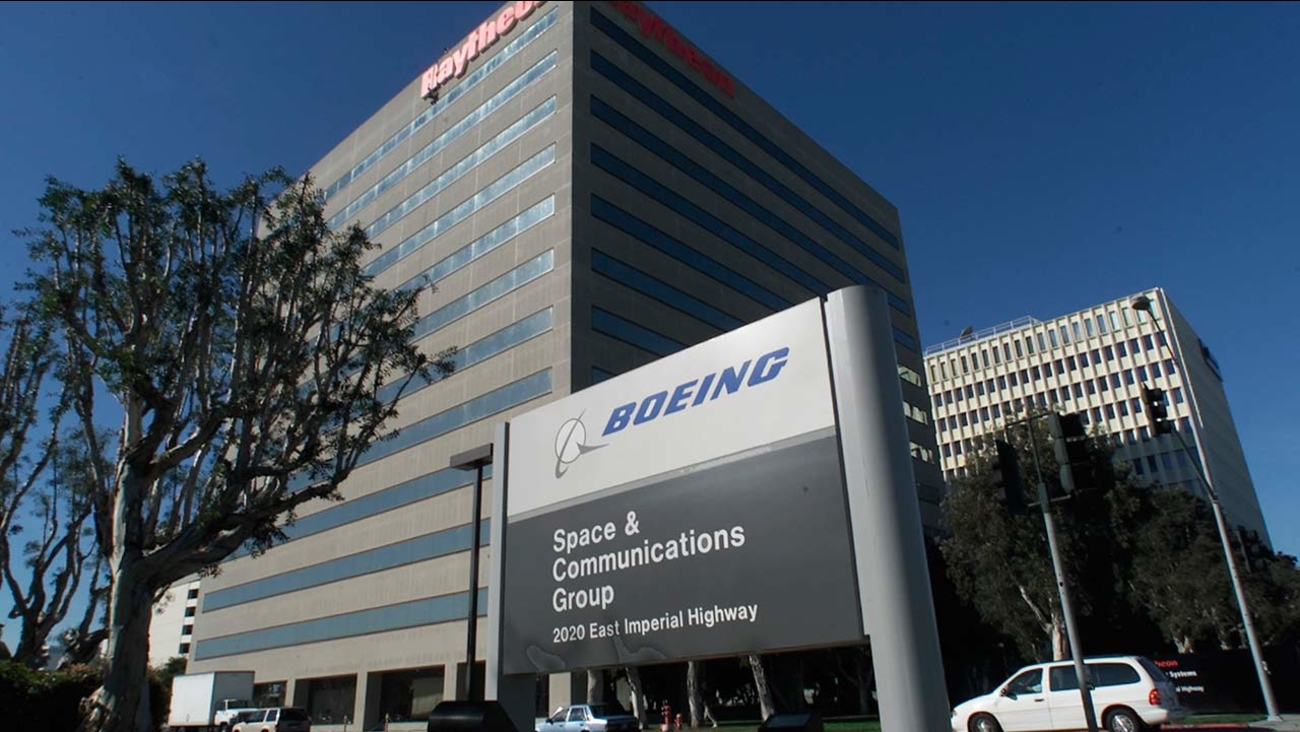The Boeing Satellite Systems building is seen on the far right, Thursday, Feb. 21, 2002 in El Segundo area of Los Angeles.