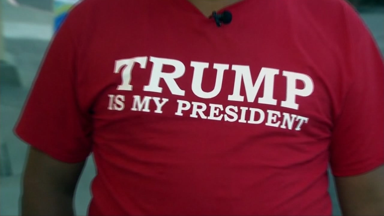 "Leo Sanchez appears wearing a T-shirt that says, ""Trump is my president."""
