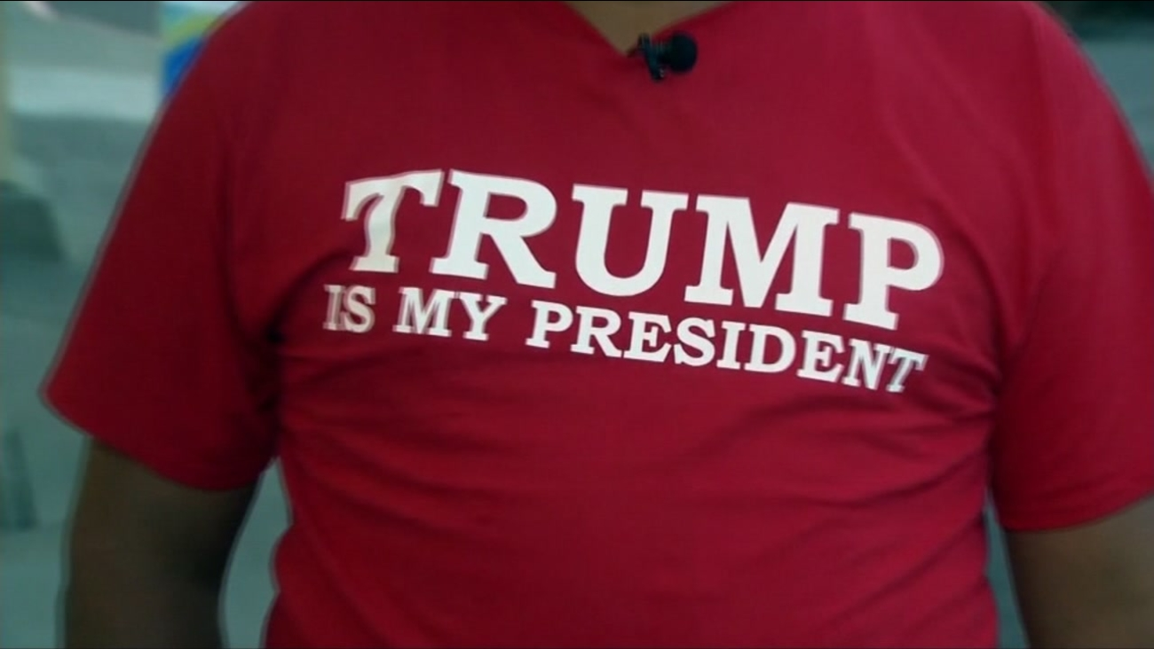 """Leo Sanchez appears wearing a T-shirt that says, """"Trump is my president."""""""