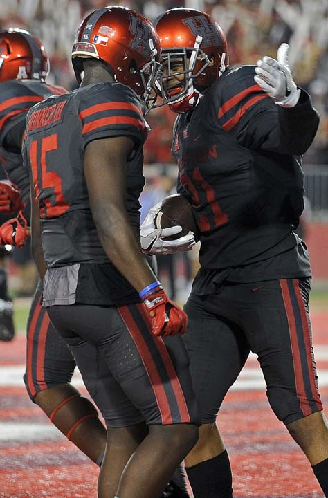 "<div class=""meta image-caption""><div class=""origin-logo origin-image ap""><span>AP</span></div><span class=""caption-text"">Houston wide receiver Chance Allen, right, celebrates his 50-yard touchdown reception with Linell Bonner during the first half. (AP Photo/Eric Christian Smith)</span></div>"