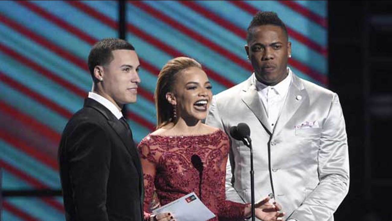 Javier Baez, from left, Leslie Grace and Aroldis Chapman present the award for best tropical fusion album at the 17th annual Latin Grammy Awards at the T-Mobile Arena.