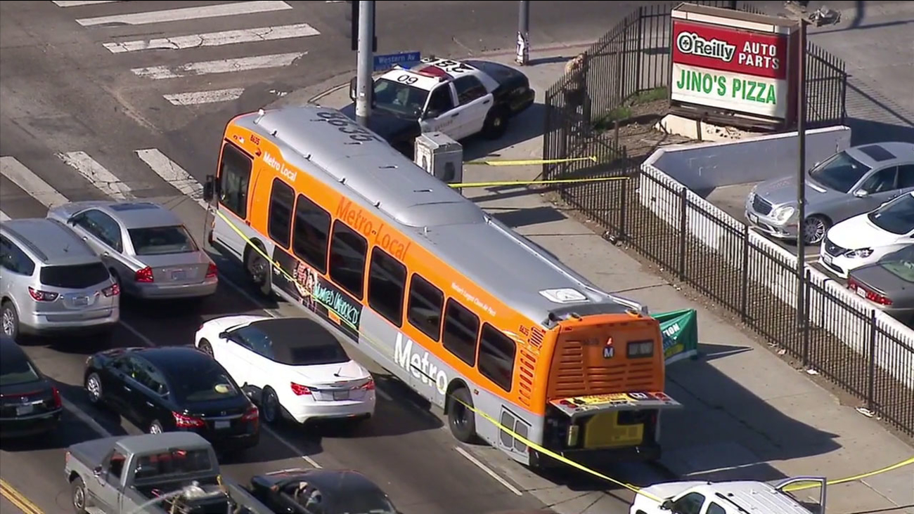 Police tape surrounds a Metro bus in South Los Angeles after a passenger died of an apparent heart attack on Friday, Nov. 18, 2016.