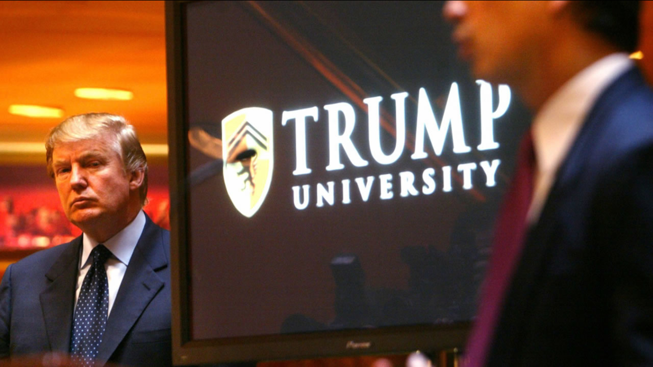 In this Monday May 23, 2005 file photo, Donald Trump listens as Michael Sexton introduces him to announce the establishment of Trump University at a press conference in New York.