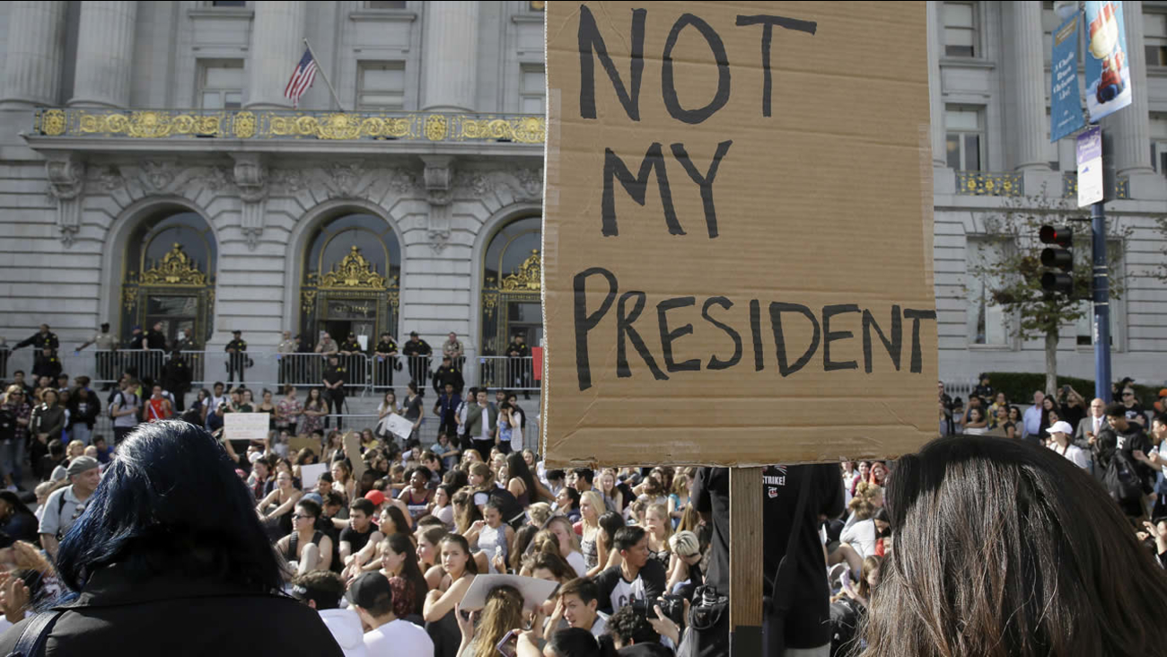 High school students protest in opposition of Donald Trump's presidential election victory in front of City Hall in San Francisco, Thursday, Nov. 10, 2016. (AP Photo/Eric Risberg)