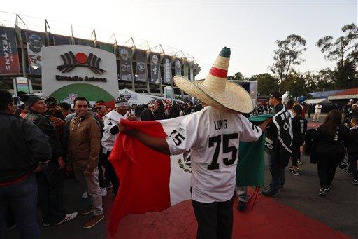 "<div class=""meta image-caption""><div class=""origin-logo origin-image ap""><span>AP</span></div><span class=""caption-text"">An Oakland Raiders fan carries a Mexican flag as he arrives to Azteca Stadium before an NFL football game against the Houston Texans Monday, Nov. 21, 2016, in Mexico City. (AP Photo/Eduardo Verdugo)</span></div>"