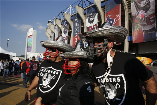 """<div class=""""meta image-caption""""><div class=""""origin-logo origin-image ap""""><span>AP</span></div><span class=""""caption-text"""">Oakland Raiders fans look at Azteca Stadium before an NFL football game against the Houston Texans Monday, Nov. 21, 2016, in Mexico City. (AP Photo/Dario Lopez-Mills)</span></div>"""