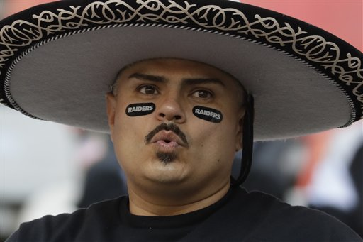 """<div class=""""meta image-caption""""><div class=""""origin-logo origin-image ap""""><span>AP</span></div><span class=""""caption-text"""">A Oakland Raiders fan looks on before an NFL football game against the Houston Texans Monday, Nov. 21, 2016, in Mexico City. (AP Photo/Rebecca Blackwell)</span></div>"""