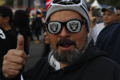 """<div class=""""meta image-caption""""><div class=""""origin-logo origin-image ap""""><span>AP</span></div><span class=""""caption-text"""">Oakland Raiders fans take pictures in front of Azteca Stadium before an NFL football game against the Houston Texans Monday, Nov. 21, 2016, in Mexico City. (AP Photo/Eduardo Verdugo)</span></div>"""