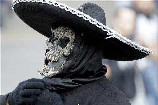 "<div class=""meta image-caption""><div class=""origin-logo origin-image ap""><span>AP</span></div><span class=""caption-text"">A Oakland Raiders fan arrives to Azteca Stadium before an NFL football game against the Houston Texans Monday, Nov. 21, 2016, in Mexico City. (AP Photo/Eduardo Verdugo)</span></div>"