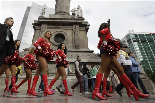 """<div class=""""meta image-caption""""><div class=""""origin-logo origin-image ap""""><span>AP</span></div><span class=""""caption-text"""">Houston Texans cheerleaders perform in front of the Angel of Independence monument Sunday, Nov. 20, 2016, in Mexico City. (AP Photo/Gregory Bull)</span></div>"""