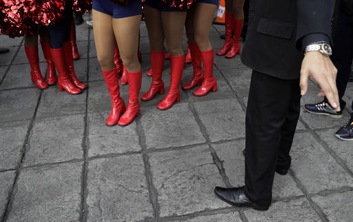"""<div class=""""meta image-caption""""><div class=""""origin-logo origin-image ap""""><span>AP</span></div><span class=""""caption-text"""">Houston Texans cheerleaders in red boots are directed to their performance area at the Angel of Independence monument in Mexico City, Sunday, Nov. 20, 2016. (AP Photo/Gregory Bull)</span></div>"""