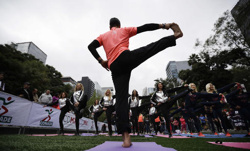 """<div class=""""meta image-caption""""><div class=""""origin-logo origin-image ap""""><span>AP</span></div><span class=""""caption-text"""">Oakland Raiders and Houston Texans cheerleaders follow a yoga instructor at the Angel of Independence monument during an NFL promotional event in Mexico City, Nov. 20, 2016. (AP Photo/Gregory Bull)</span></div>"""