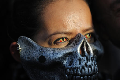 """<div class=""""meta image-caption""""><div class=""""origin-logo origin-image ap""""><span>AP</span></div><span class=""""caption-text"""">A dressed up Oakland Raiders fan poses for photos as she arrives at Azteca stadium in Mexico City, Monday, Nov. 21, 2016. (AP Photo/Dario Lopez-Mills)</span></div>"""