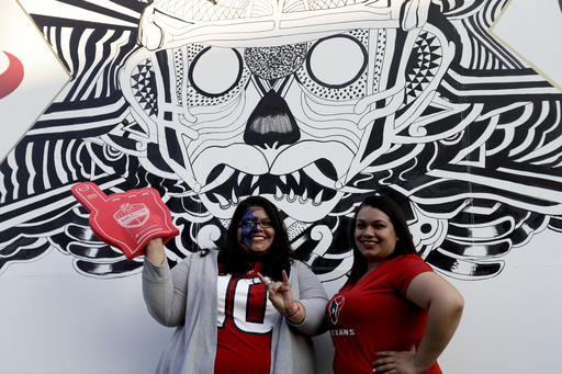 """<div class=""""meta image-caption""""><div class=""""origin-logo origin-image ap""""><span>AP</span></div><span class=""""caption-text"""">Houston Texans fans pose for a picture outside of Azteca Stadium Monday, Nov. 21, 2016, in Mexico City. (AP Photo/Rebecca Blackwell)</span></div>"""