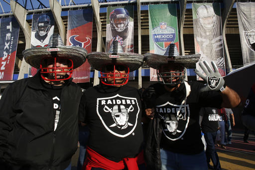"""<div class=""""meta image-caption""""><div class=""""origin-logo origin-image ap""""><span>AP</span></div><span class=""""caption-text"""">Oakland Raiders fans pose for a picture in front of Azteca Stadium before an NFL football game against the Houston Texans Monday, Nov. 21, 2016, in Mexico City. (AP Photo/Dario Lopez-Mills))</span></div>"""