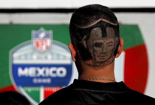 """<div class=""""meta image-caption""""><div class=""""origin-logo origin-image ap""""><span>AP</span></div><span class=""""caption-text"""">A Oakland Raiders fan arrives at Azteca Stadium before an NFL football game against the Houston Texans Monday, Nov. 21, 2016, in Mexico City. (AP Photo/Dario Lopez-Mills)</span></div>"""