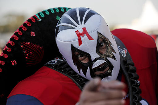 """<div class=""""meta image-caption""""><div class=""""origin-logo origin-image ap""""><span>AP</span></div><span class=""""caption-text"""">A Houston Texans fan poses before an NFL football game against the Oakland Raiders Monday, Nov. 21, 2016, in Mexico City. (AP Photo/Dario Lopez-Mills)</span></div>"""