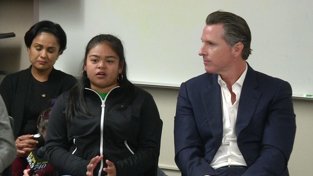 This image shows by Lieutenant Governor Gavin Newsom with a student at Burton High School in San Francisco, Calif. on Nov. 21, 2016.