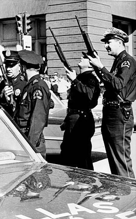 """<div class=""""meta image-caption""""><div class=""""origin-logo origin-image none""""><span>none</span></div><span class=""""caption-text"""">Police officers with guns ready look up the building where the shot came from that killed U.S. President John F. Kennedy while he was riding in an open limousine through Dallas (AP Photo/XCB)</span></div>"""