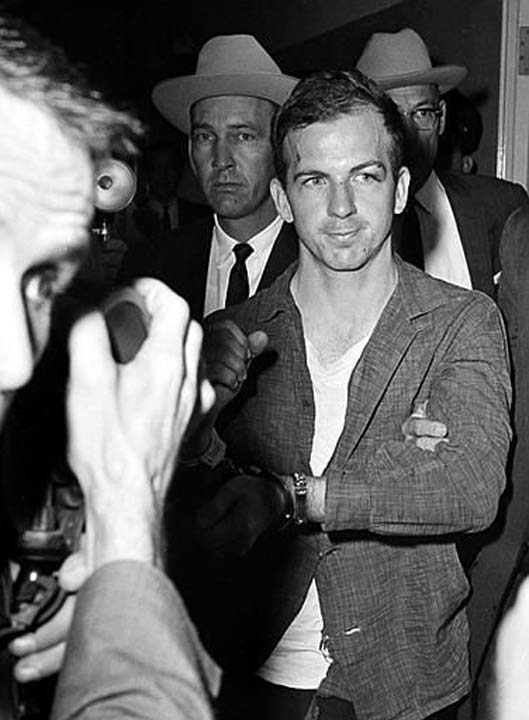 """<div class=""""meta image-caption""""><div class=""""origin-logo origin-image none""""><span>none</span></div><span class=""""caption-text"""">Lee Harvey Oswald, suspected assassin of U.S. President John F. Kennedy, at police headquarters in Dallas where he is held for questioning (AP Photo/Ferd Kaufman, AP Photo/XCB)</span></div>"""