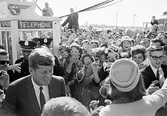 """<div class=""""meta image-caption""""><div class=""""origin-logo origin-image none""""><span>none</span></div><span class=""""caption-text"""">President John F. Kennedy and his wife Jacqueline Kennedy are greeted by an enthusiastic crowd as they arrive at Dallas Love Field on Nov. 22, 1963 (AP Photo/XCB)</span></div>"""
