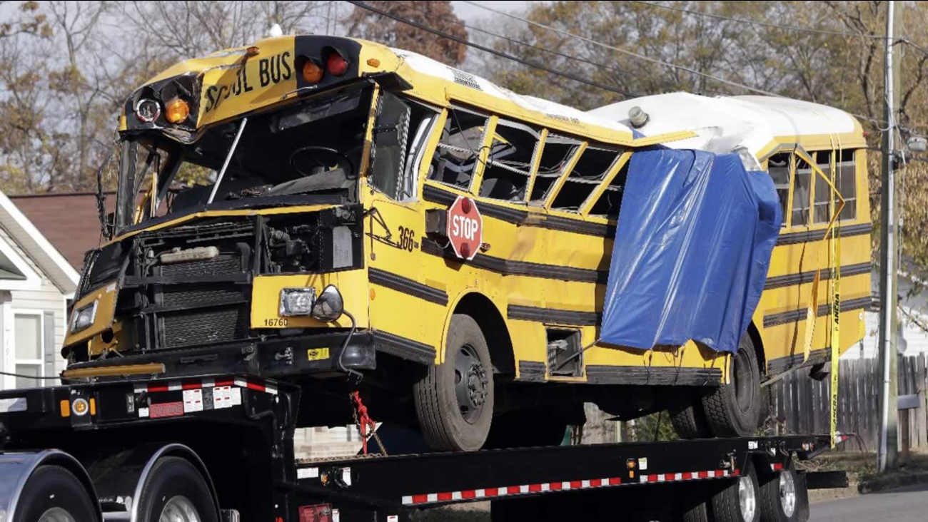 A school bus is carried away Tuesday, Nov. 22, 2016, in Chattanooga, Tenn, from the site where it crashed Monday, Nov. 21.