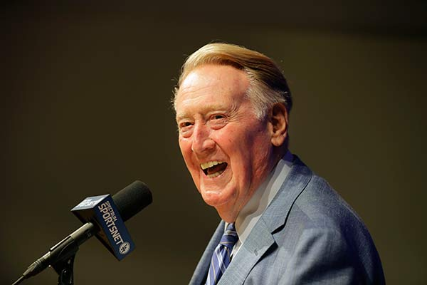 "<div class=""meta image-caption""><div class=""origin-logo origin-image ap""><span>AP</span></div><span class=""caption-text"">Vin Scully is a broadcaster who, for 67 seasons, was the voice of the Brooklyn and Los Angeles Dodgers.</span></div>"