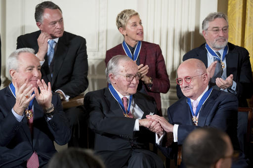 """<div class=""""meta image-caption""""><div class=""""origin-logo origin-image ap""""><span>AP</span></div><span class=""""caption-text"""">Miami Dade College President Eduardo Padron shakes hands with attorney and former Chair of the Federal Communications Commission Newt Minow (AP Photo/Andrew Harnik) (AP)</span></div>"""