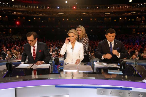 "<div class=""meta image-caption""><div class=""origin-logo origin-image ap""><span>AP</span></div><span class=""caption-text"">Moderators Bret Baier, Megyn Kelly and Chris Wallace take the stage before a Republican presidential primary debate at Fox Theatre in Detroit. (AP Photo/Paul Sancya)</span></div>"