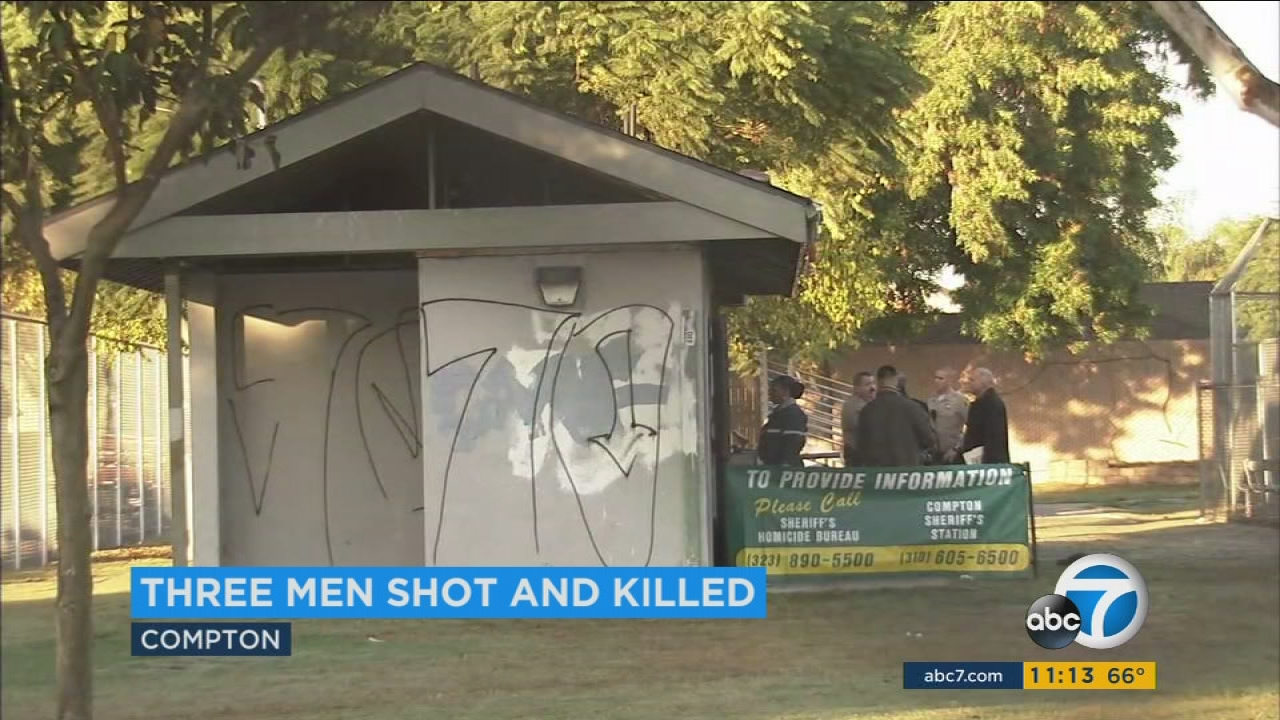 Investigators are seen at a Compton Park, where three men were found fatally shot inside a maintenance shack on Tuesday, Nov. 22, 2016.