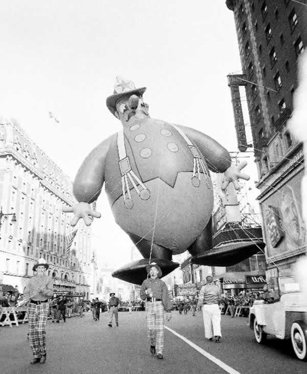 <div class='meta'><div class='origin-logo' data-origin='none'></div><span class='caption-text' data-credit='AP Photo/John Rooney'>A huge balloon in the form of comic fireman floats over Broadway during the annual Macy's Thanksgiving Day Parade in New York, Nov. 25, 1948.</span></div>
