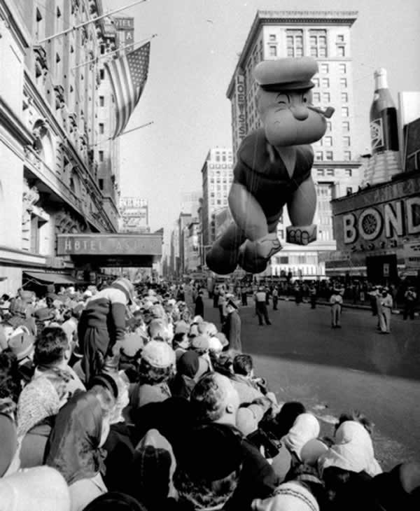 <div class='meta'><div class='origin-logo' data-origin='none'></div><span class='caption-text' data-credit='AP Photo'>Helium-filled Popeye balloon floats above some of the 1,300,000 persons watching the 33rd Macy's Thanksgiving Day Parade pass through Times Square, New York, November 26, 1959.</span></div>