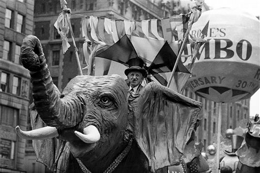 "<div class=""meta image-caption""><div class=""origin-logo origin-image ap""><span>AP</span></div><span class=""caption-text"">Comedian Jimmy Durante rides on a Jumbo the elephant float during the annual Macy's Thanksgiving Day Parade in New York City on Nov. 22, 1962.</span></div>"