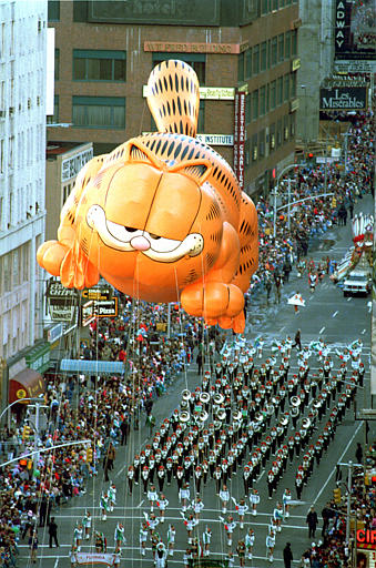 "<div class=""meta image-caption""><div class=""origin-logo origin-image ap""><span>AP</span></div><span class=""caption-text"">Garfield the Cat floats above a marching band on Broadway in the Macy's Thanksgiving Day parade in New York City, Thursday, Nov. 27, 1986.</span></div>"