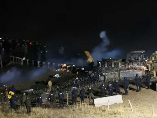 <div class='meta'><div class='origin-logo' data-origin='none'></div><span class='caption-text' data-credit='(Morton County Sheriff's Department via AP)'>Law enforcement and protesters clash near the site of the Dakota Access pipeline on Sunday, Nov. 20, 2016, in Cannon Ball, N.D.</span></div>