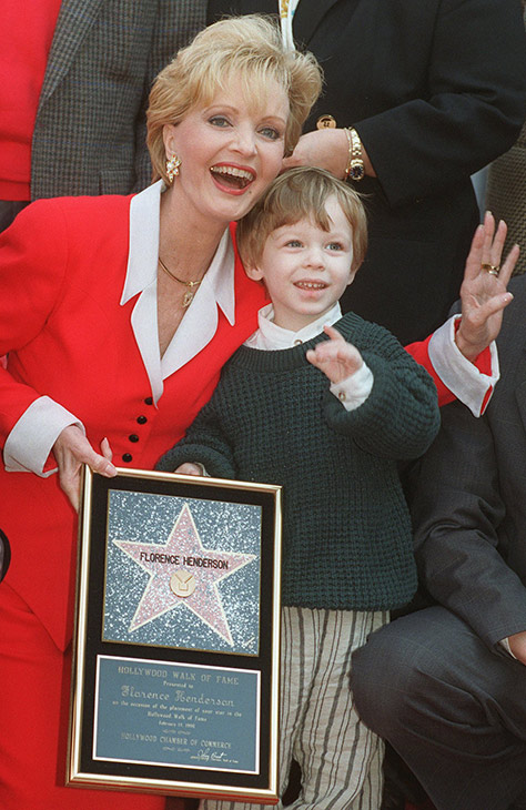 <div class='meta'><div class='origin-logo' data-origin='AP'></div><span class='caption-text' data-credit='AP Photo/Chris Pizzello'>Florence Henderson celebrates receiving the 2,061st star on the Hollywood Walk of Fame with her grandson Kyle Russell, 2, Wednesday, Feb. 14, 1996, in Hollywood.</span></div>