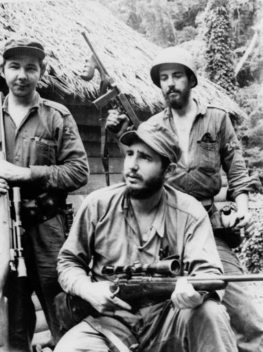 "<div class=""meta image-caption""><div class=""origin-logo origin-image none""><span>none</span></div><span class=""caption-text"">In this March 14, 1957 file photo, Fidel Castro, the young anti-Batista guerrilla leader, center, is seen with his brother Raul Castro,  (AP Photo/Andrew St. George)</span></div>"