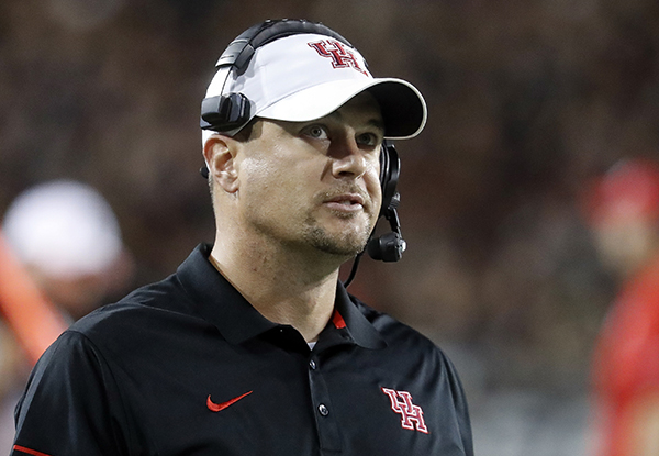 <div class='meta'><div class='origin-logo' data-origin='AP'></div><span class='caption-text' data-credit='AP'>FILE - In this Sept. 15, 2016, file photo, Houston coach Tom Herman stands on the sideline during the first half of an NCAA college football game against Cincinnati in Cincinnati.</span></div>